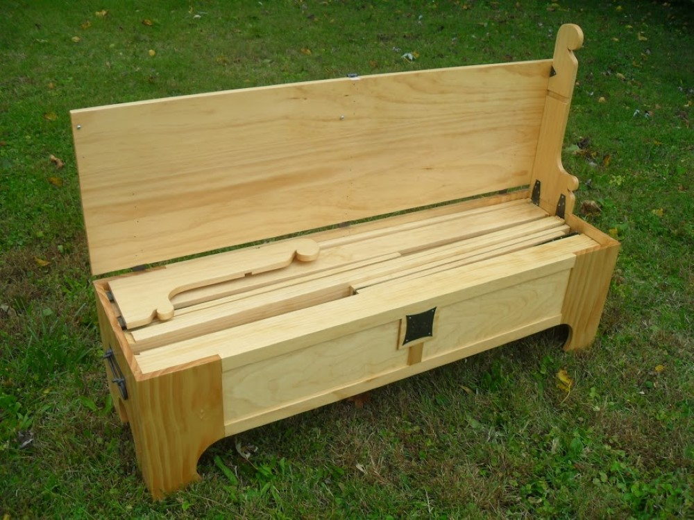 This Amazing Fold Up Bed Can Be Stored In A Small Wooden