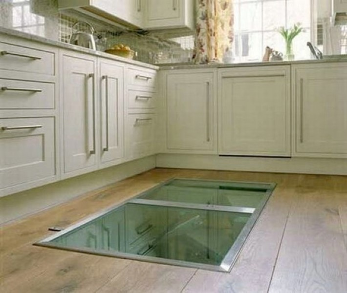 weird hidden window on kitchen floor leads to wine cellar